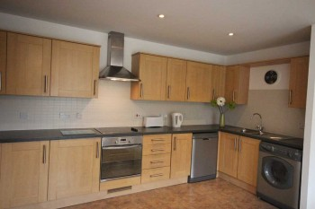 Kitchen to the Academy serviced apartments in Luton