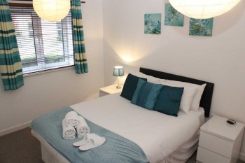 Bedroom to the serviced apartment at Centro development in Northampton
