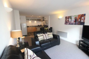 Open-plan living area of this 1 bedroom serviced apartment at Centro, Northampton.
